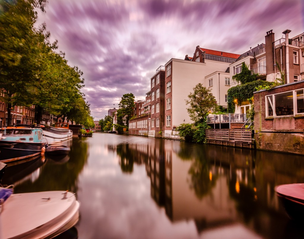 Amsterdam Architecture amid Water and Clouds