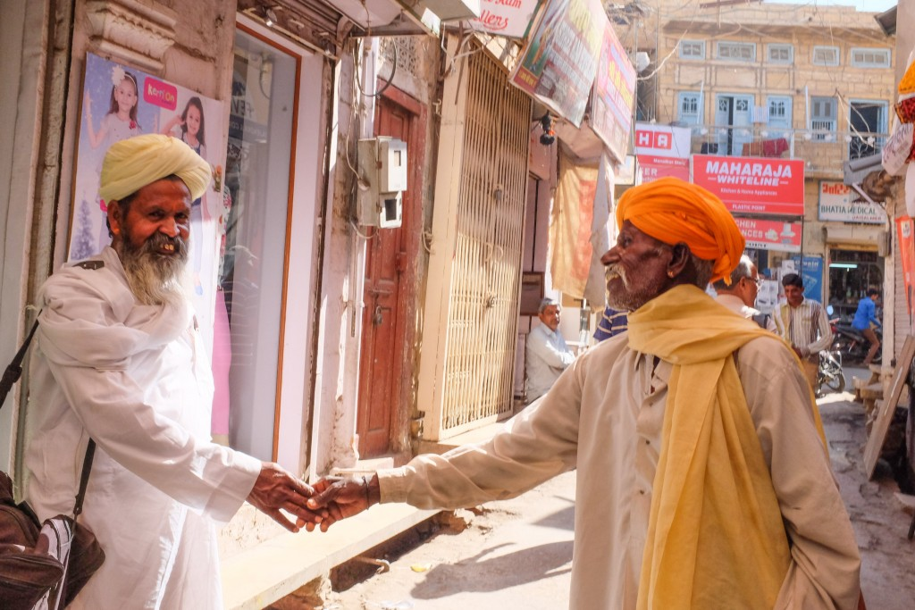 A warm handshake adds colour to life in Rajasthan