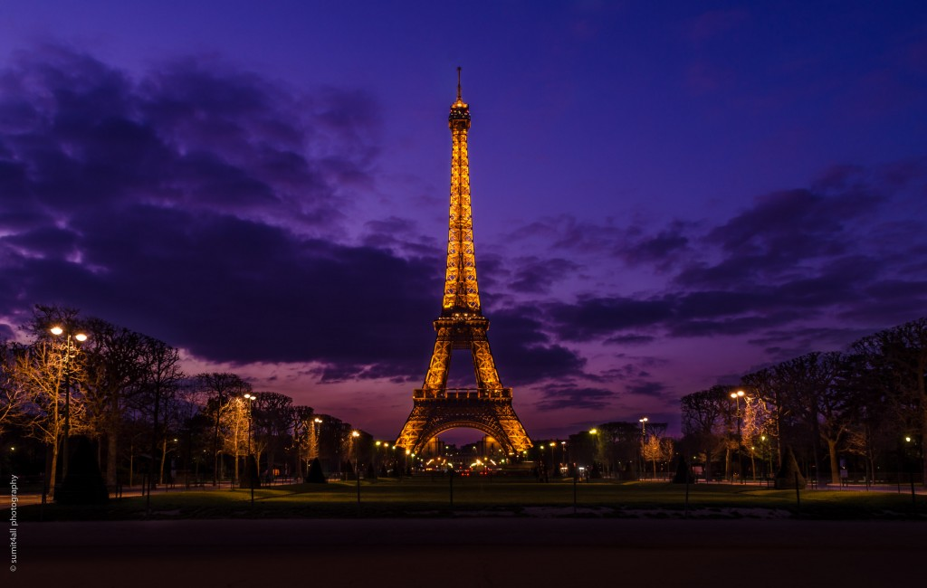 The Eiffel Tower during a cloudy sunset evening