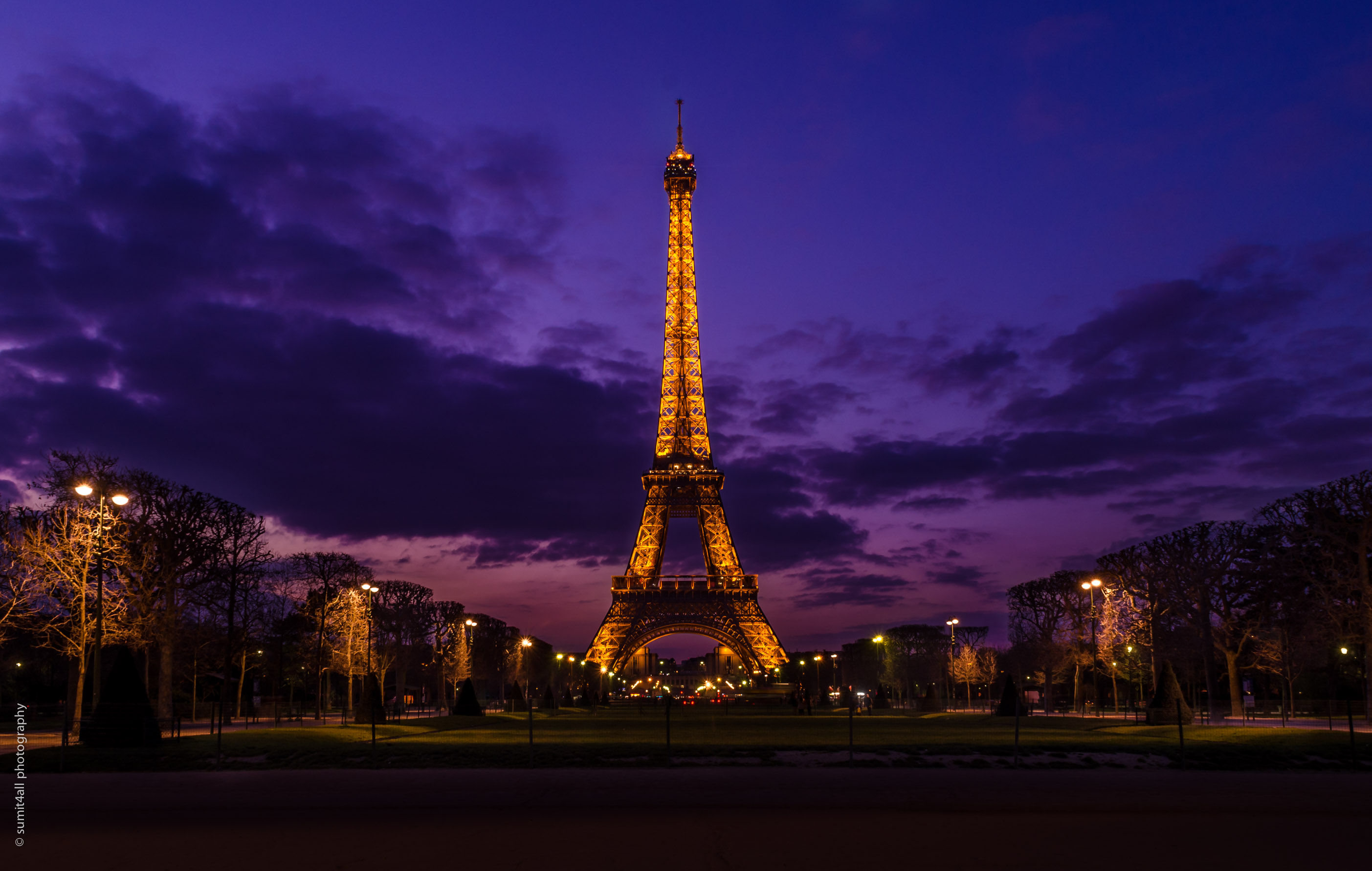the eiffel tower and a cloudy sunset
