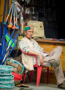 A local trader sits outside his shop in Manali Mall Road