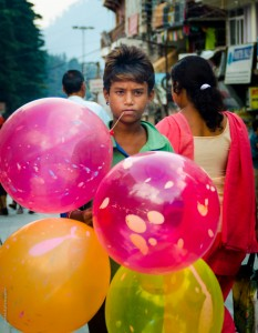 Innocence in the eyes of a child balloon seller in Manali