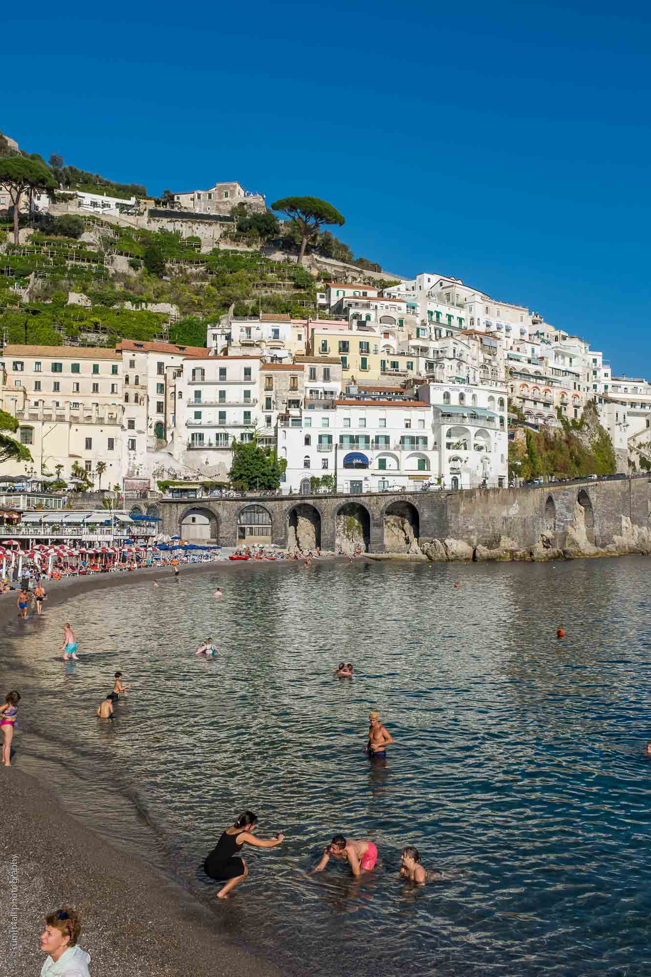 People Enjoying by the Coast in Amalfi, Italy