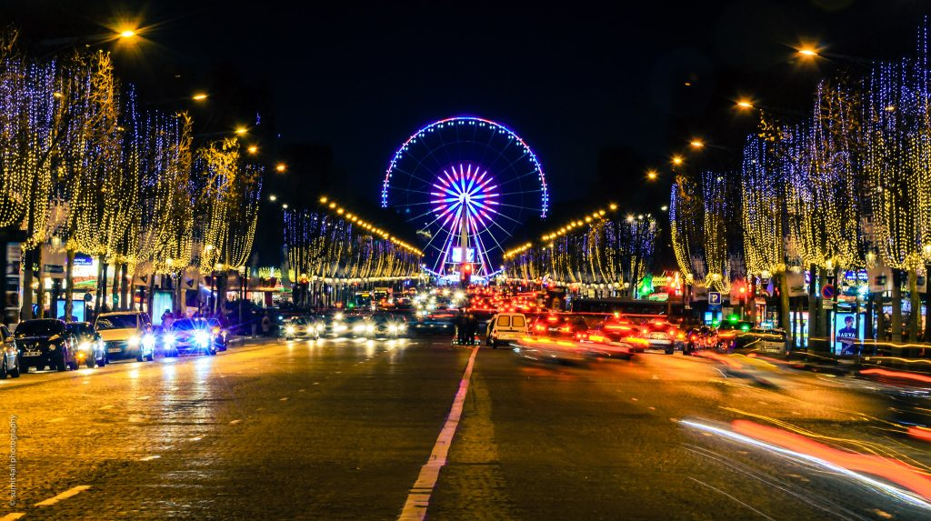 The Egyptian Obelisk and the Giant Wheel put up during Christmas at the Place de la Concorde as seen from the Champs Elysees which is also illuminated