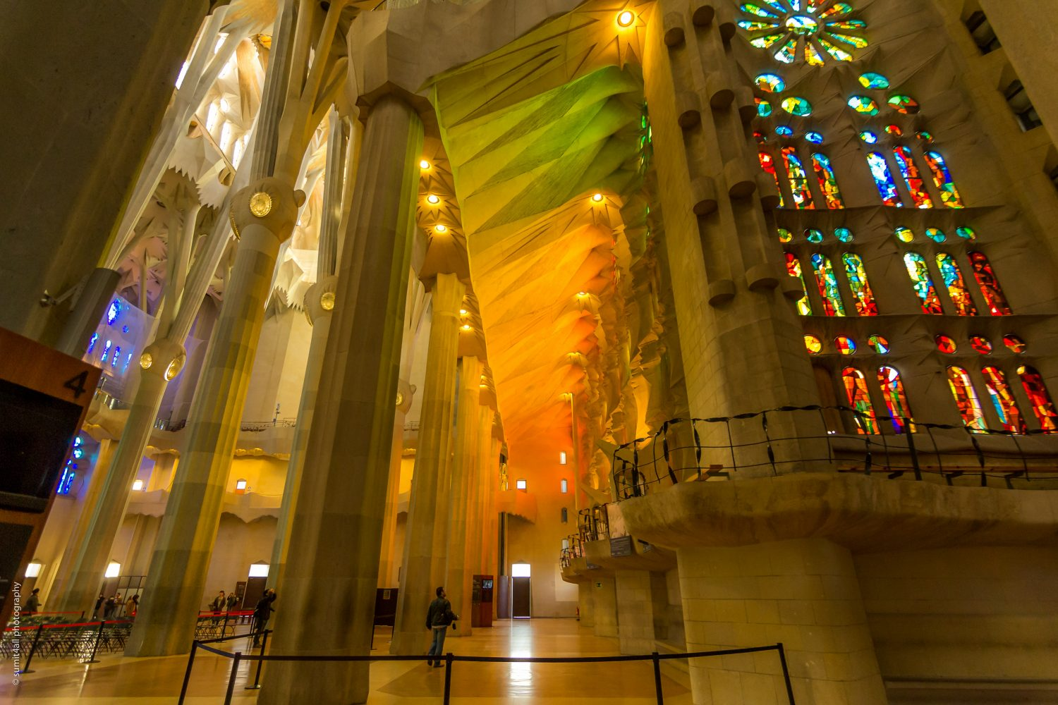 Shades of different colors formed by light coming through the stained glass windows inside the Sagrada Familia
