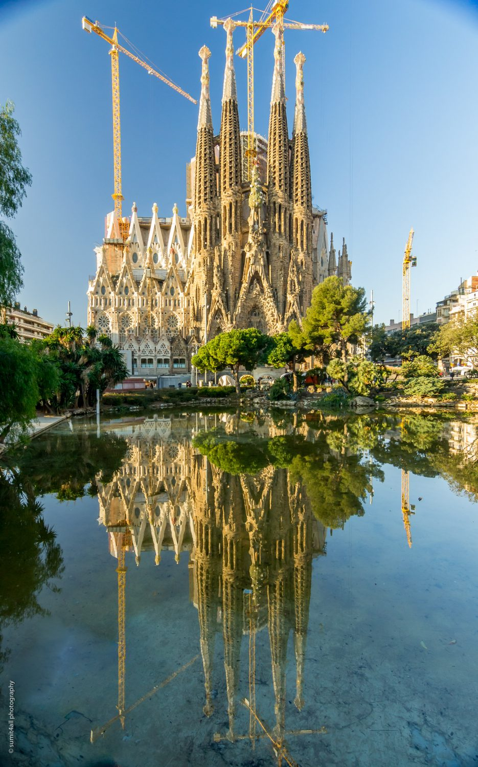 The reflection of the Sagrada Familia in the small pond in front