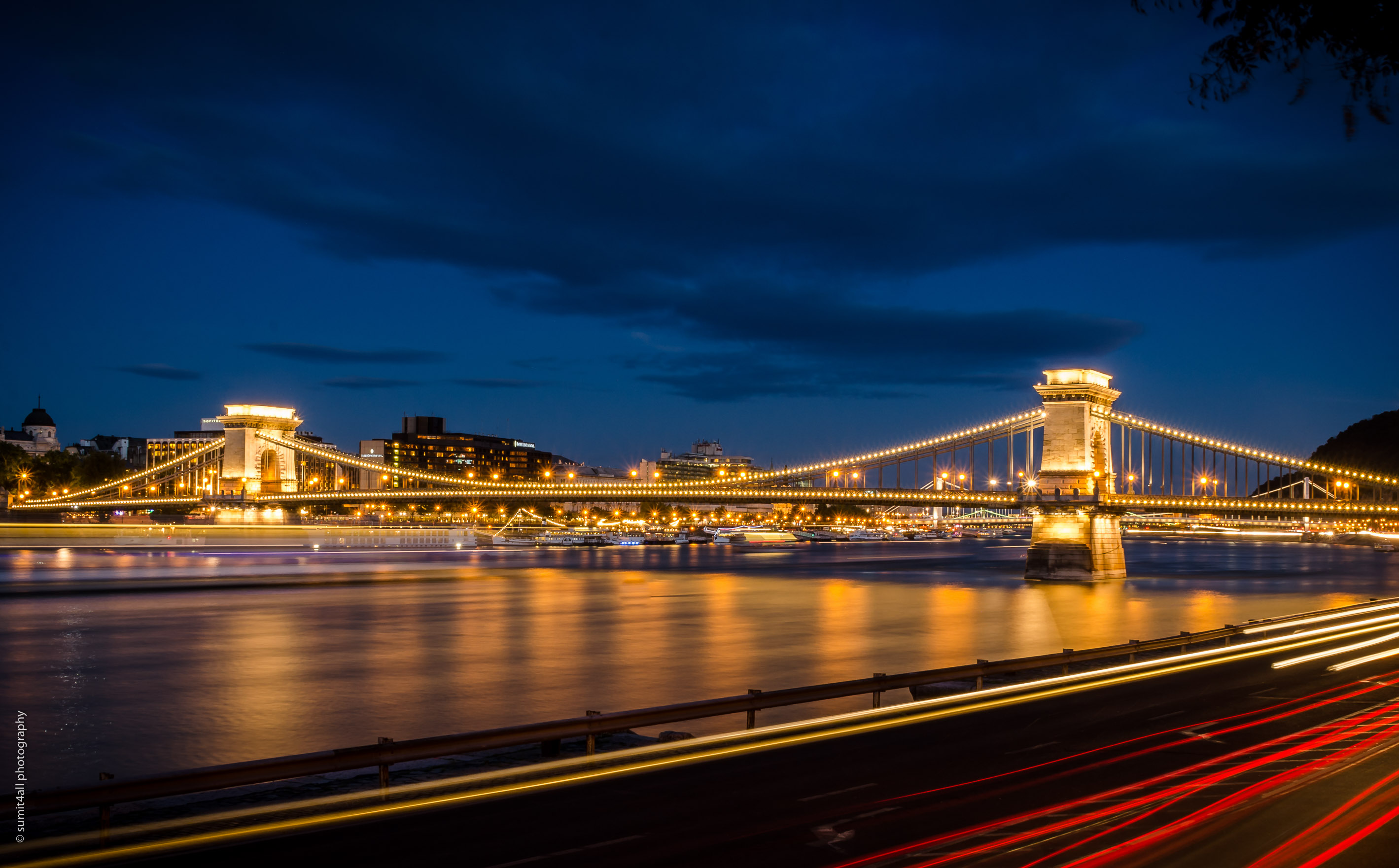 The Chain Bridge after sunset on the Danube river. The roads on both sides of the river are always jammed with traffic.