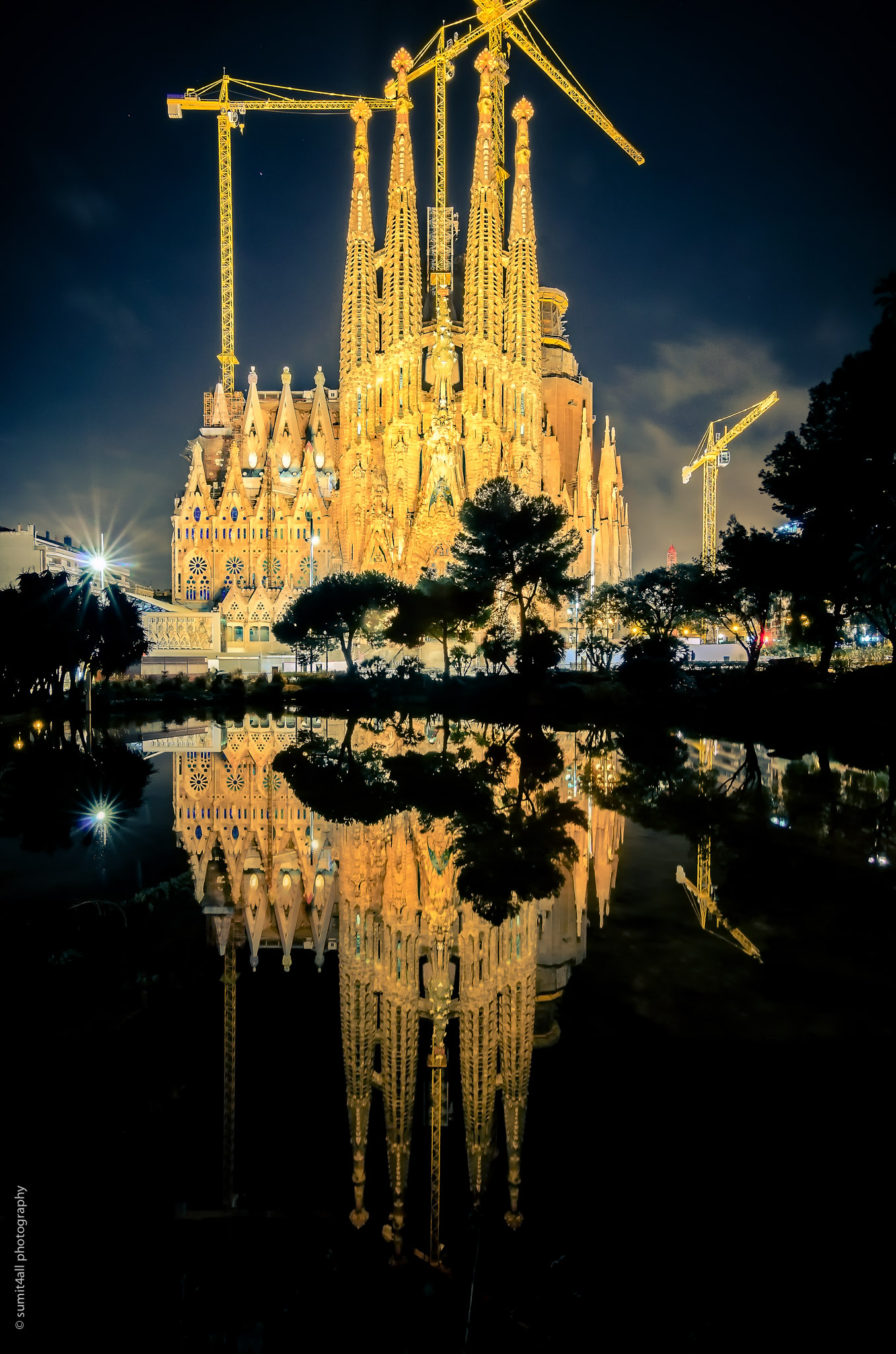 Sagrada Familia and its reflection at night in Barcelona, Spain