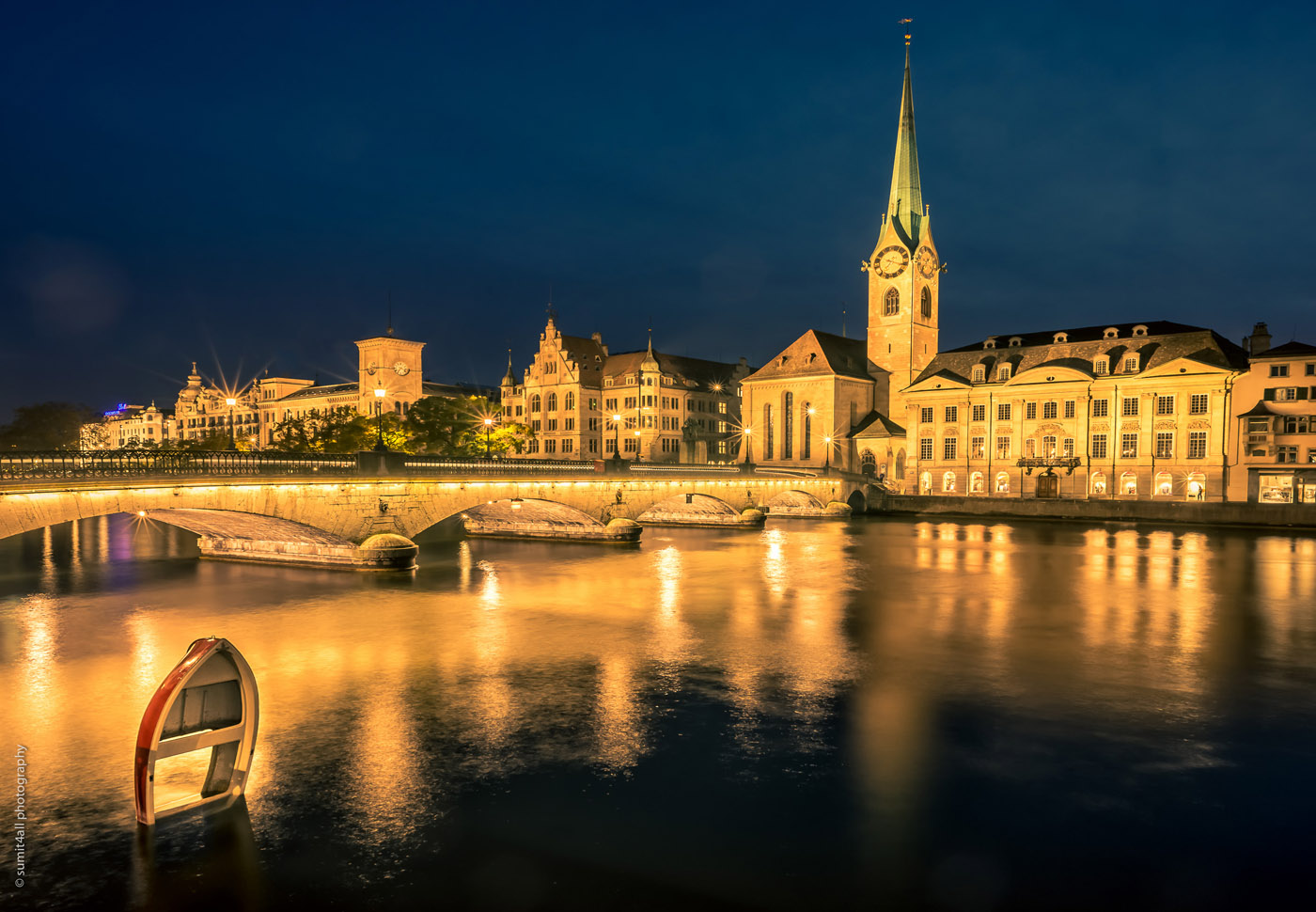 Glittering lights and still waters in the city of Zurich after nightfall.