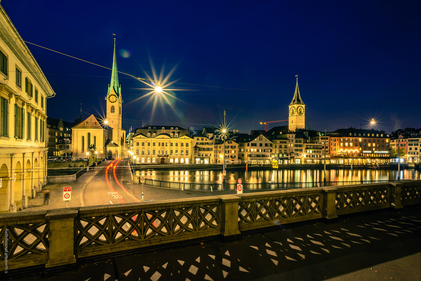 Artificial lights lit up the city of Zurich after sunset.