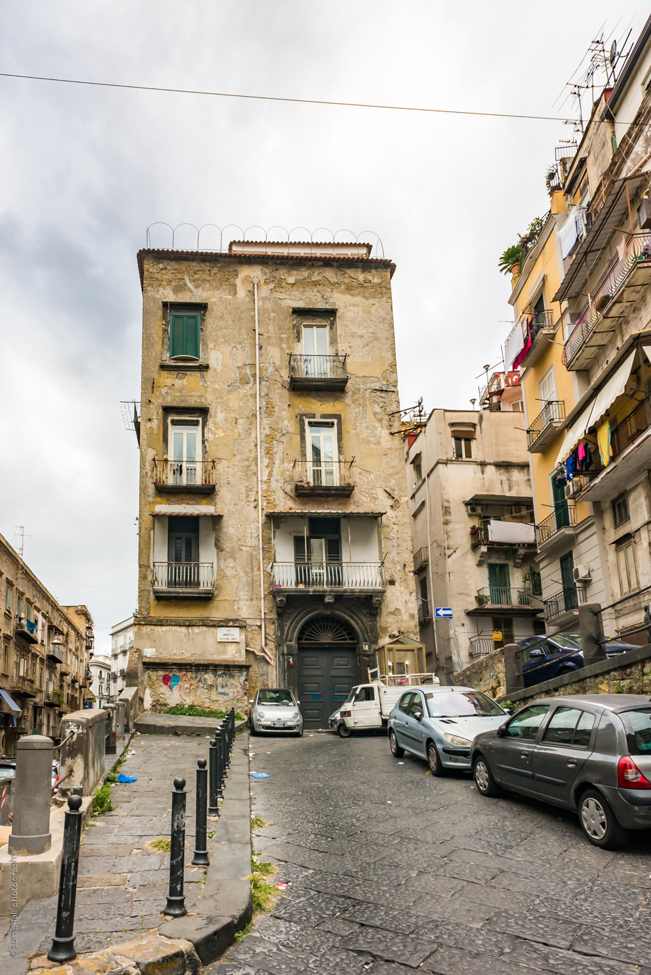 an old and worn out building in the centre of naples, italy