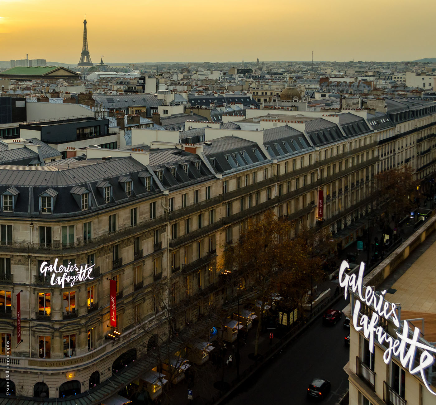 The Eiffel visible during sunset from atop the Galleries Lafayette in Paris
