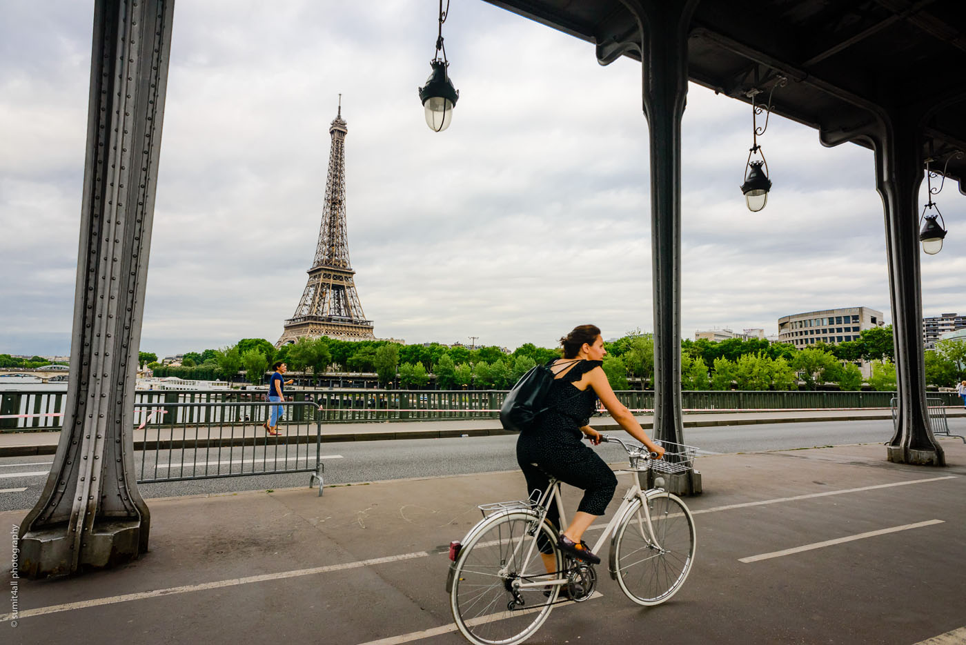A cyclist goes past the Eiffel on the Bir Hakeim bridge in Paris