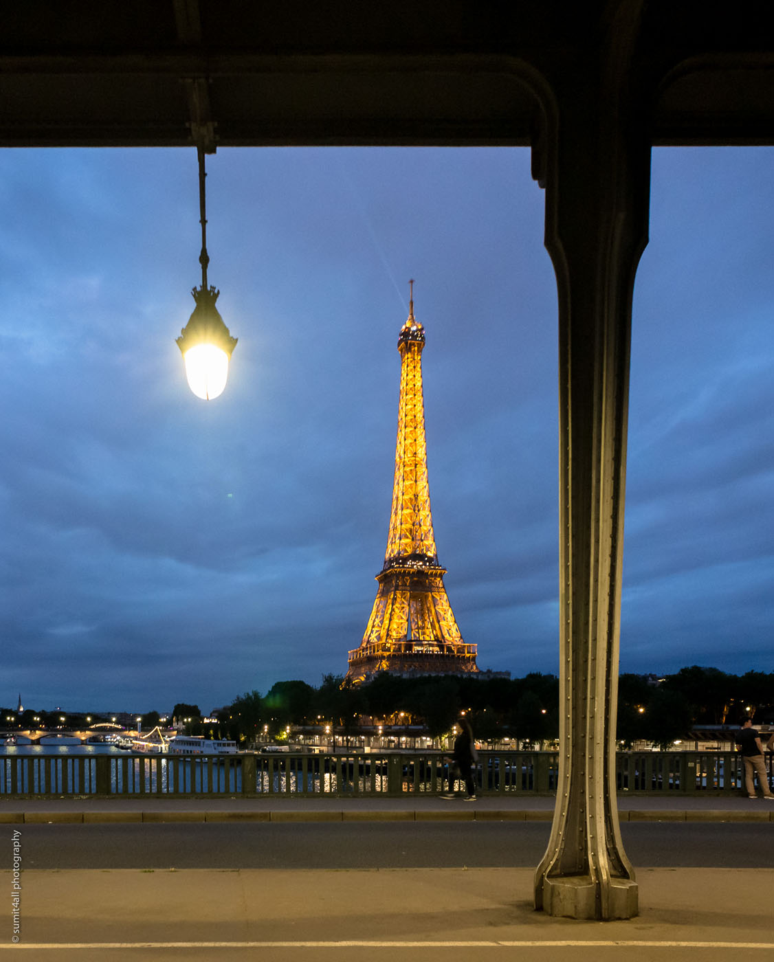 The lights of the Eiffel Tower from the Bir Hakeim bridge, which is also lit with small and beautiful bulbs