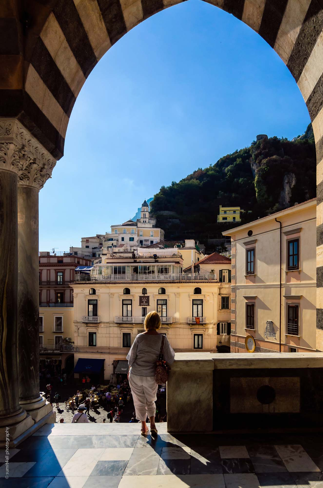 A Lady pondering over something in Amalfi, Italy