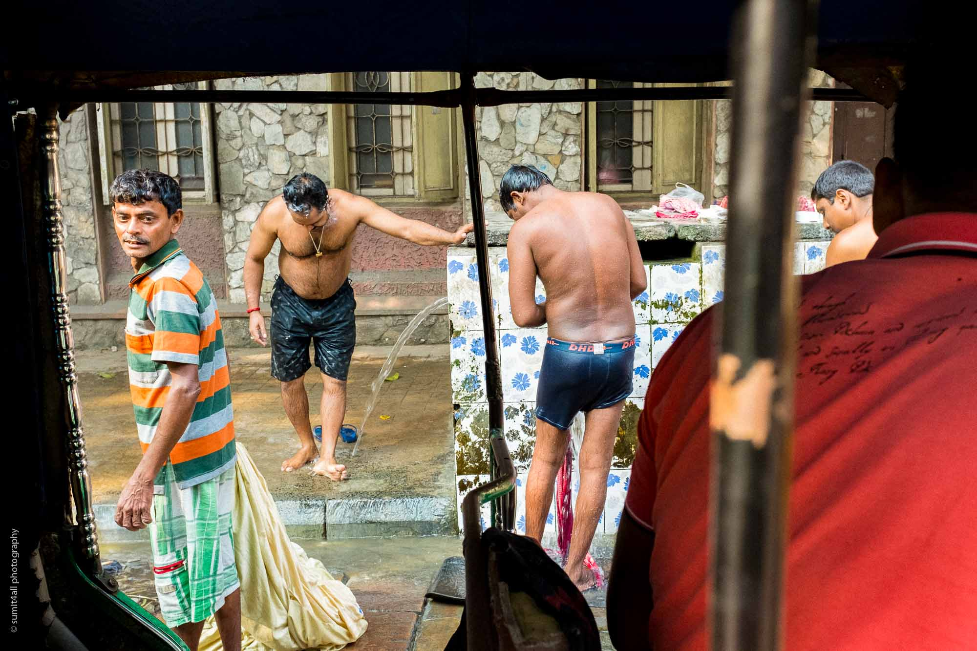 People bathing on the streets in Kolkata