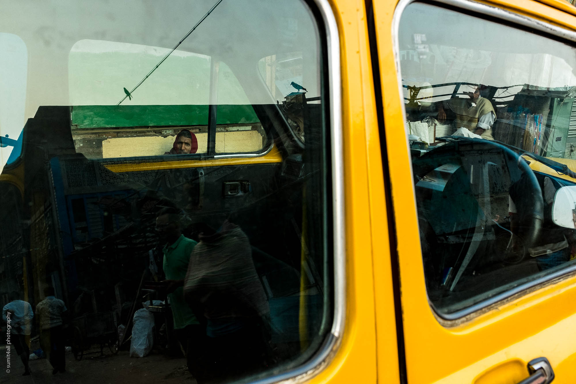 Reflections on a Yellow Taxi in Kolkata