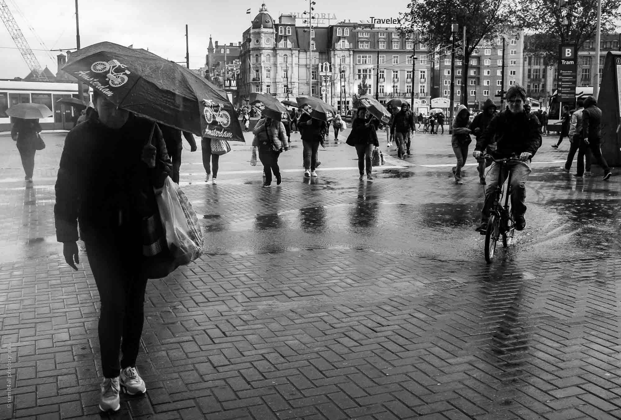 A Sudden Rainshower has People Running for Cover in Amsterdam