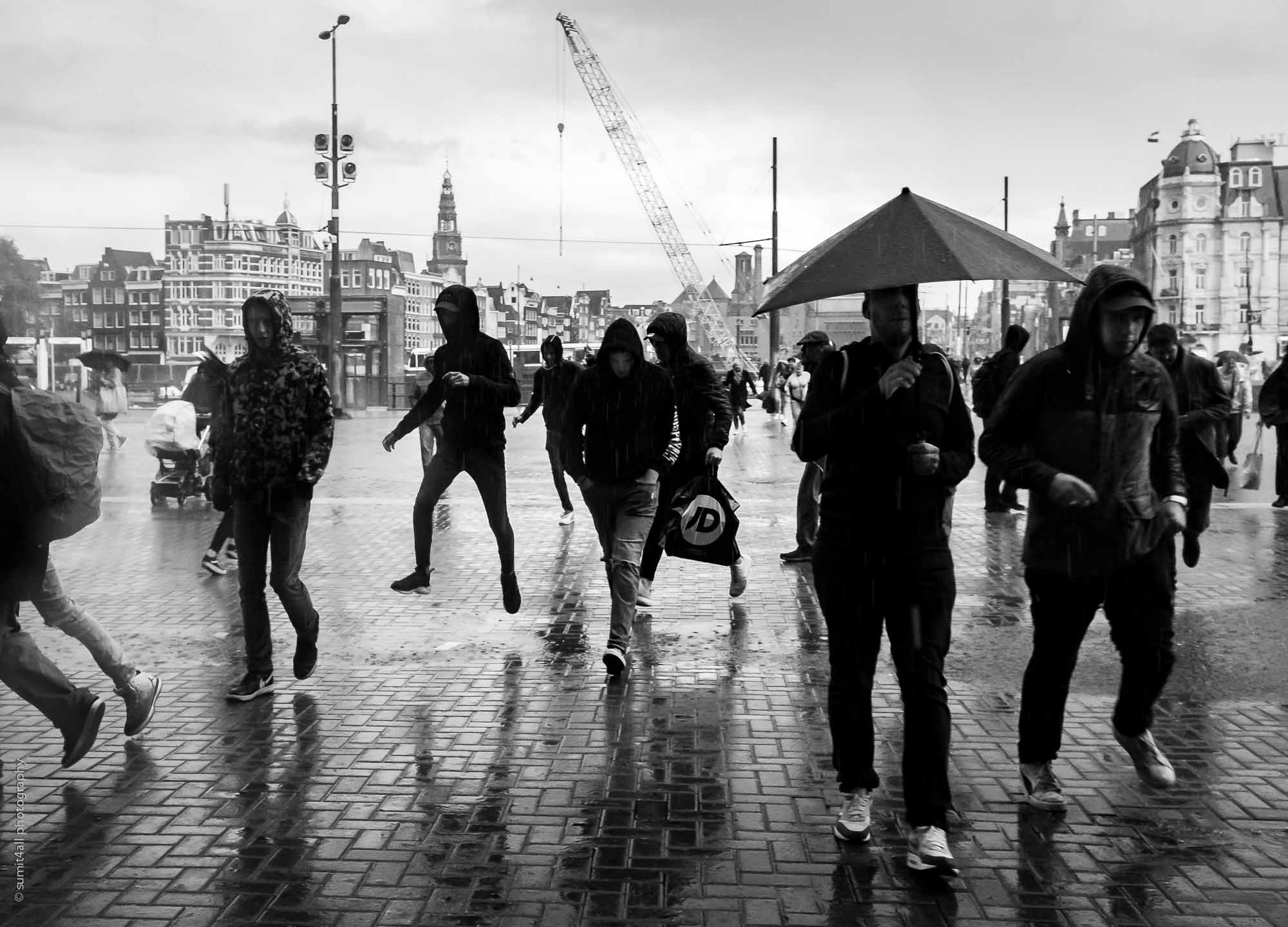 A Sudden Rain-shower has People Running for Cover in Amsterdam